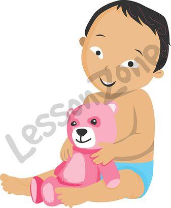 Baby boy holding teddy bear